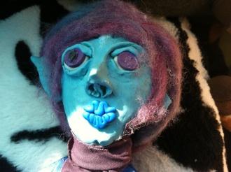 After a run sad hope puppet, missing an ear.